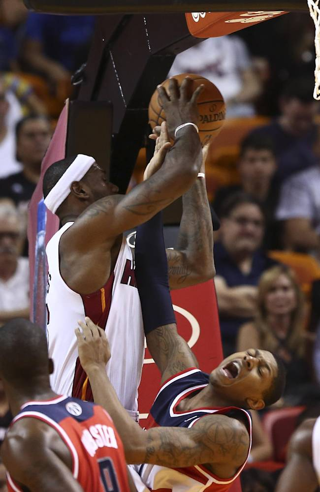 Miami Heat's LeBron James (6) gets over Washington Wizards' Bradley Beal (3) for a two point shot during the second half of an NBA basketball game in Miami, Sunday, Nov. 3, 2013