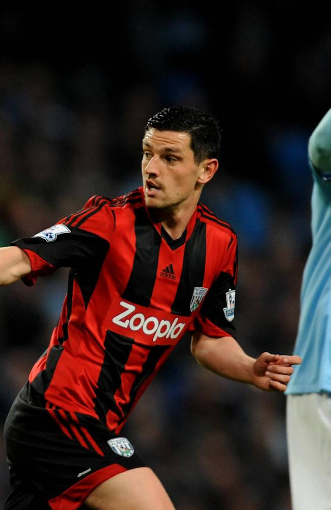 West Bromwich Albion's Graham Dorrans, left, celebrates scoring against Manchester City during their English Premier League soccer match at the Etihad Stadium, Manchester, England, Monday April  21, 2014
