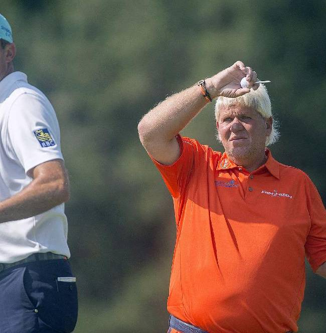 Americans John Daly, right, and Matt Kuchar look down the fairway during a practice round at the Canadian Open golf tournament at Royal Montreal Golf Club in Montreal, Quebec, Tuesday, July 22, 2014