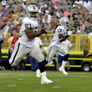Oakland Raiders running back Maurice Jones-Drew (21) rushes for a touchdown against the Green Bay Packers during the first half of an NFL preseason football game Friday, Aug. 22, 2014, in Green Bay, Wis The Associated Press