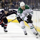 Dallas Stars' Colton Sceviour, right, carries the puck against Columbus Blue Jackets' Matt Calvert during the second period of an NHL hockey game in Columbus, Ohio, Tuesday, Oct. 14, 2014 The Associated Press
