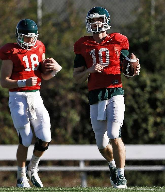 In a photo from Dec. 27, 2013, Michigan State backup quarterback Andrew Maxwell (10) and quarterback Connor Cook (18) finish a drill during MSU's 2014 Rose Bowl practice at the StubHub Center in Carson, Calif. Maxwell, the former starter talked Sunday about the bittersweet journey of his senior season. Maxwell told MLive.com in Los Angeles that the sweetness of reaching the Rose Bowl far outweighs the bitterness he had to endure when he lost a much-publicized quarterback competition to current Spartans' starter Connor Cook in September