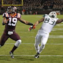 Miami wide receiver Braxton Berrios (83) reaches for a pass in the end zone as Virginia Tech cornerback Chuck Clark (19) defends during the first half of an NCAA college football game in Blacksburg, Va., Thursday, Oct. 23, 2014. The pass was incomplete. (AP Photo/Steve Helber)