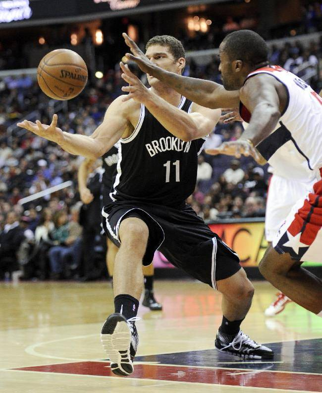 Brooklyn Nets center Brook Lopez (11) battles for the ball against Washington Wizards forward Martell Webster during the first half of an NBA basketball game Friday, Nov. 8, 2013, in Washington