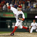 In this Sept. 8, 2014 file photo, Washington Nationals relief pitcher Drew Storen (22) throws during a baseball game against the Atlanta Braves at Nationals Park in Washington. Storen and the Ntionals agreed Friday to a one-year deal The Associated Press