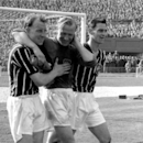 FILE - A May 5, 1956 photo from files of Bernd Trautmann, more commonly known as Bert, Manchester City's German-born goalkeeper, centre, being assisted from the pitch by two unidentified players, suffering from a broken neck, during the FA Cup final against Birmingham, at London's Wembley Stadium. The German football federation said Friday, July 19, 2013, that Trautmann died in La Llosa, near Valencia, Spain, where he lived. Trautmann's wife Marlies told the federation he died Friday morning. Trautmann had suffered two heart attacks this year but appeared to have recovered well. Manchester City called Trautmann one of the club's