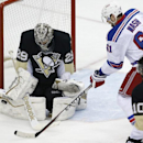 Pittsburgh Penguins goalie Marc-Andre Fleury (29) stops a shot by New York Rangers' Rick Nash (61) during the first period of an NHL hockey game in Pittsburgh, Sunday, Jan. 18, 2015 The Associated Press