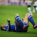 Chelsea's Fernando Torres lies on the pitch after being fouled during UEFA Champions League Round of 16, First Leg match between Galatasaray and Chelsea at Turk Telekom Arena Stadium in Istanbul, Turkey, Wednesday, Feb. 26, 2014. (AP Photo)