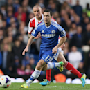 Chelsea's Eden Hazard, front, takes the ball away from Stoke City's Andy Wilkinson during their English Premier League soccer match between Chelsea and Stoke City at Stamford Bridge stadium in London, Saturday, April, 5, 2014