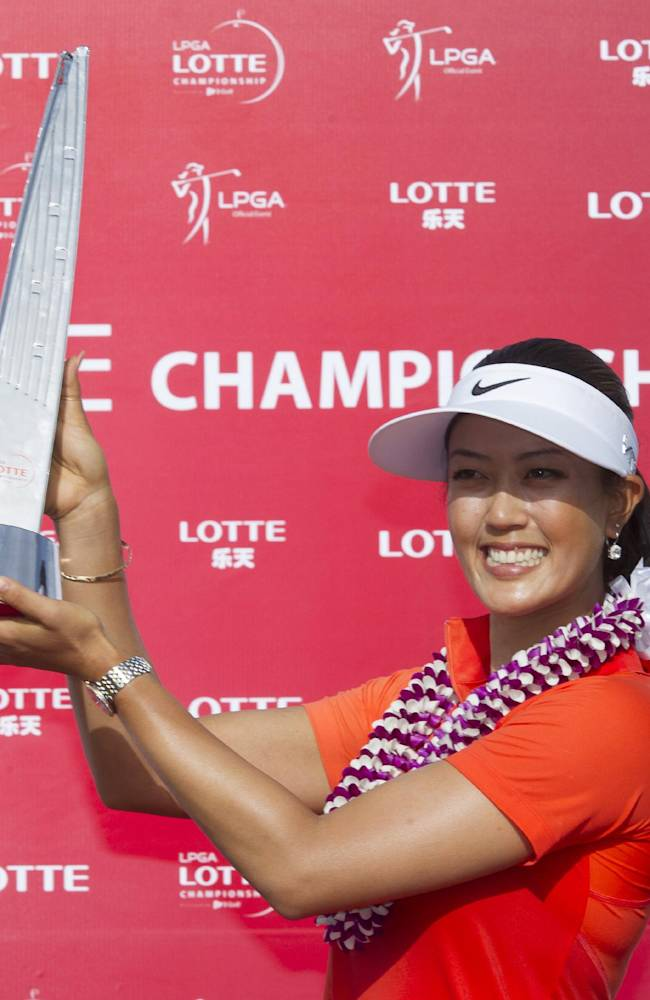 Michelle Wie holds up the 2014 LPGA LOTTE Championship trophy at Ko Olina Golf Club, Saturday, April 19, 2014, in Kapolei, Hawaii