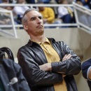 FILE - In this March 2, 2013, file photo, West Virginia athletic director Oliver Luck watches a women's NCAA college basketball game between Baylor and West Virginia at WVU Coliseum in Morgantown, W.Va. A person with direct knowledge of the hiring tells The Associated Press that West Virginia athletic director Oliver Luck is joining the NCAA to take a high-ranking position on President Mark Emmert's staff. The person spoke on condition of anonymity Wednesday, Dec. 17, 2014, because an announcement was being prepared by the NCAA. (AP Photo/David Smith, File)