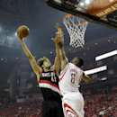 Portland Trail Blazers' Robin Lopez (42) puts up a shot against Houston Rockets' Terrence Jones (6) during the first half in Game 2 of an opening-round NBA basketball playoff series Wednesday, April 23, 2014, in Houston The Associated Press