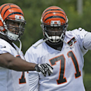 Cincinnati Bengals tackle Andre Smith (71) works with tackle Marshall Newhouse during the NFL football team's first practice at training camp, Thursday, July 24, 2014, in Cincinnati. (AP Photo) The Associated Press