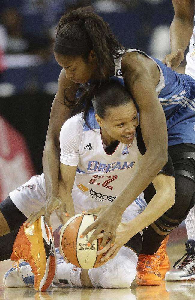 Minnesota Lynx' Devereaux Peters (14) vies for a loose ball against Atlanta Dream's Armintie Herrington (22) during the first half of Game 3 of the WNBA Finals basketball game in Duluth, Ga., Thursday, Oct. 10, 2013