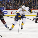 Nashville Predators left wing James Neal (18) moves past Colorado Avalanche left wing Cody McLeod (55) and a tripped-up Maxime Talbot, right, during the second period of an NHL hockey game Tuesday, Dec. 9, 2014, in Denver The Associated Press