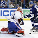 Montreal Canadiens goalie Carey Price (31) stops Tampa Bay Lightning center Nate Thompson (44) on a breakaway in overtime of Game 1 of a first-round NHL hockey playoff series on Wednesday, April 16, 2014, in Tampa, Fla. The Canadiens won the game 5-4 The