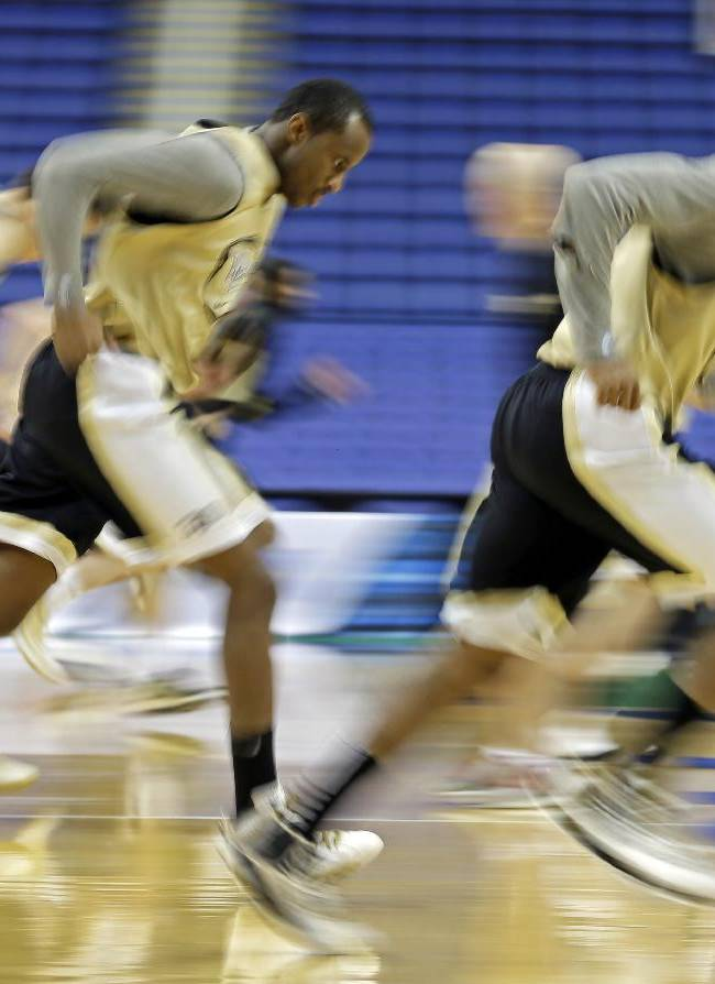 Wake Forest's Travis McKie, left, and Coron Williams, right, run with the team during an NCAA college basketball practice for the Atlantic Coast Conference tournament in Greensboro, N.C., Tuesday, March 11, 2014. Wake Forest plays Notre Dame in a first round game on Wednesday