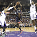New Orleans Pelicans guard Tyreke Evans, center, drives to the basket between Sacramento Kings' Derrick Williams, left, and Jason Thompson during the first quarter of an NBA basketball game in Sacramento, Calif., Monday, March 3, 2014 The Associated Pres