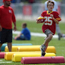 Kansas City Chiefs fans run through the kids zone area during a NFL training camp, Wednesday, July 30, 2014 on the Missouri Western State University campus in St. Joseph. Mo The Associated Press
