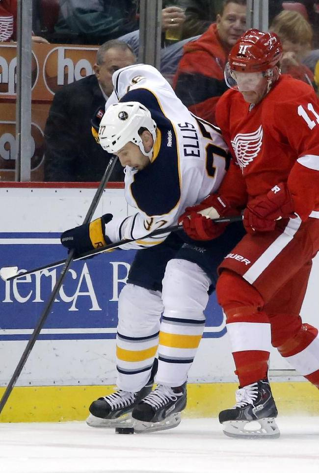 Detroit Red Wings' Daniel Alfredsson (11), of Sweden, tries to keep Buffalo Sabres' Matt Ellis (37) off the puck during the first period of an NHL hockey game Friday, April 4, 2014, in Detroit
