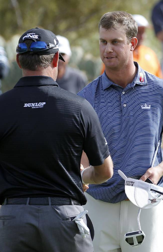 Harris English shakes hands with Lee Westwood, of England after winning his match during the first round of the Match Play Championship golf tournament on Wednesday, Feb. 19, 2014, in Marana, Ariz