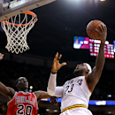 COLUMBUS, OH - OCTOBER 20: LeBron James #23 of the Cleveland Cavaliers shoots against Tony Snell #20 of the Chicago Bulls on October 20, 2014 at Schottenstein Center in Columbus, Ohio. (Photo by Gary Dineen/NBAE via Getty Images)
