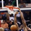 Charlotte Bobcats center Bismack Biyombo (0) scores against the Atlanta Hawks in the first half of an NBA basketball game against the Atlanta Hawks in Atlanta Monday, April 14, 2014 The Associated Press