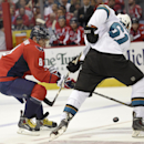 Washington Capitals left wing Alex Ovechkin (8), of Russia, fights for the puck against San Jose Sharks defenseman Justin Braun (61) during the second period of an NHL hockey game, Tuesday, Oct. 14, 2014, in Washington The Associated Press
