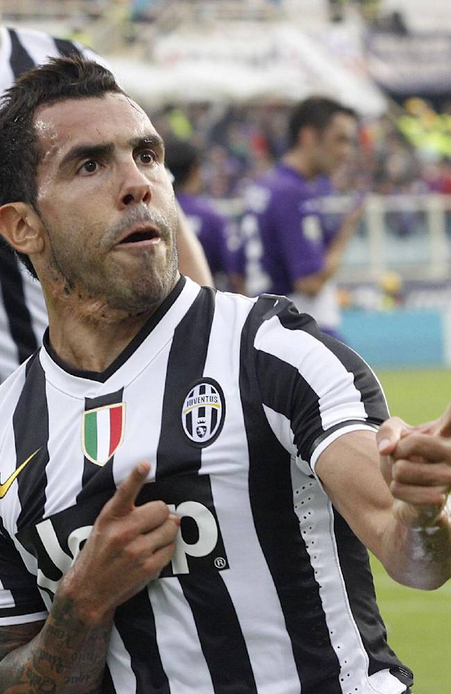 Juventus' Carlos Tevez, of Argentina, celebrates after scoring on a penalty during a Serie A soccer match between Fiorentina and Juventus at the Artemio Franchi stadium in Florence, Italy, Sunday, Oct. 20, 2013