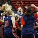 Fresno State's Robin Draper, center, celebrates with her team after winning the Mountain West Conference tournament championship NCAA college basketball game against San Diego State, Saturday, March 16, 2013, in Las Vegas. Fresno State won 76-70. (AP Photo/Isaac Brekken)