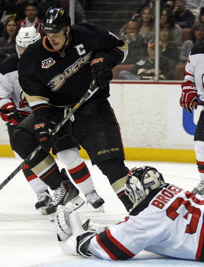 Anaheim Ducks center Ryan Getzlaf, left, controls the puck against New Jersey Devils goalie Martin Brodeur (30) during the first period of an NHL hockey game on Wednesday, Nov. 20, 2013, in Anaheim, Calif