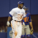 Toronto Blue Jays' Edwin Encarnacion reacts after being hit by a pitch as New York Mets catcher Anthony Recker looks on during ninth inning pre-season major league baseball action Friday, March 28, 2014 in Montreal The Associated Press