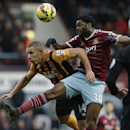 West Ham's Alex Song, right, competes for the ball with Hull City's Jake Livermore during the English Premier League soccer match between West Ham and Hull City at Upton Park stadium in London, Sunday, Jan. 18, 2015