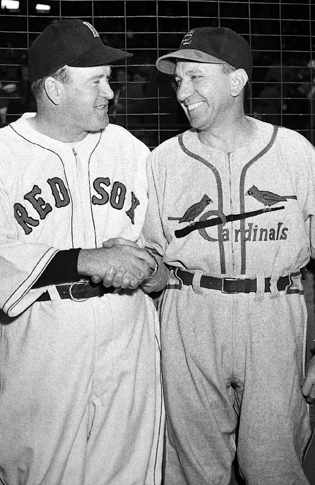 In this Oct. 9, 1946, file photo, Boston Red Sox manager Joe Cronin and St. Louis Cardinals manager Eddie Dyer shake hands before Game 3 of the World Series in Boston. The World Series starts in Boston on Wednesday, Oct. 23, 2013, when the Red Sox will play the Cardinals in a rematch of the 1946, 1967 and 2004 Series