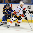Calgary Flames' Dennis Wideman (6) looks to pass around St. Louis Blues' Paul Stastny (26) during the second period of an NHL hockey game, Saturday, Oct. 11, 2014, in St. Louis The Associated Press
