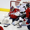 Los Angeles Kings left wing Dwight King (74) shoots his goal between the legs of Washington Capitals goalie Jaroslav Halak (41), from the Czech Republic, in the third period of an NHL hockey game, Tuesday, March 25, 2014, in Washington. The Kings won 5-4