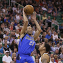 Dallas Mavericks' Devin Harris (20) passes the ball as Utah Jazz's Diante Garrett defends during the second quarter of an NBA basketball game Tuesday, April 8, 2014, in Salt Lake City The Associated Press