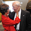 Pat Dye, right, is greeted by Barbara Dooley, wife of retired Georgia coach Vince Dooley, at the Georgia-Florida Hall of Fame inductions Friday, Oct. 31, 2014, in Jacksonville, Fla The Associated Press