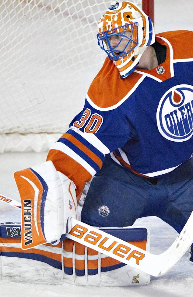 Edmonton Oilers' Ben Scrivens (30) makes a save against the Anaheim Ducks during second-period NHL hockey game action in Edmonton, Alberta, Friday, March 28, 2014