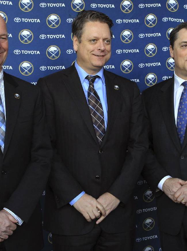 Craig Patrick, left, Tim Murray, center, and Pat LaFontaine pose for a photo after a news conference naming Murray as general manager of the Buffalo Sabres NHL hockey team and Patrick as special assistant and adviser to the hockey department, Thursday, Jan. 9, 2014, in Buffalo N.Y. LaFontaine  is president of the team