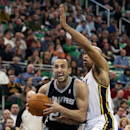 San Antonio Spurs' Manu Ginobili , left, drives to the basket past Utah Jazz's Richard Jefferson during the second half of an NBA basketball game in Salt Lake City, Friday, Nov. 15, 2013. The Spurs beat the Jazz 91-82. (AP photo/George Frey) The Associate