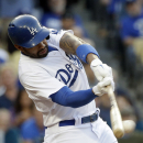 Los Angeles Dodgers' Matt Kemp hits a two-RBI double during the fifth inning of a baseball game against the Arizona Diamondbacks, Saturday, April 19, 2014, in Los Angeles The Associated Press