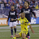 Columbus Crew forward Federico Higuain (10) threads the ball past New England Revolution midfielders Lee Nguyen (24) and Jermaine Jones (13) during the first half of their MLS soccer match Saturday, Oct. 4, 2014 in Foxborough, Mass The Associated Press
