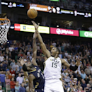 Utah Jazz's Derrick Favors (15) scores as New Orleans Pelicans' Tyreke Evans (1) defends in the fourth quarter of an NBA basketball game Wednesday, Nov. 13, 2013, in Salt Lake City. The Jazz won 111-105 The Associated Press