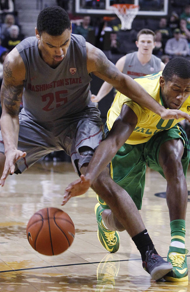 Washington State's DaVonte Lacy, left, looses control of the ball under pressure from Oregon's Mike Moser, right, during the second half of an NCAA college basketball game in Eugene, Ore., Sunday, Feb. 23, 2014
