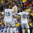 Chelsea's Diego Costa, second right, celebrates with teammates after scoring during the English Premier League soccer match between Watford and Chelsea at Vicarage Road stadium in London, Saturday, Aug. 20, 2016.(AP Photo/Frank Augstein)