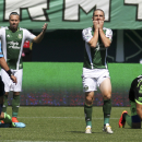 Portland Timbers player Will Johnson, standing right, reacts after after being called for a foul as his team played against the Seattle Sounders in an MLS soccer match in Portland, Ore., Sunday, Aug. 24, 2014. The Sounders won the game 4 to 1 The Associat