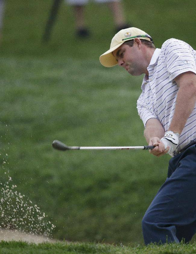 International team player Marc Leishman, of Australia, hits out of the bunker on the 14th hole during the foursome match at the Presidents Cup golf tournament at Muirfield Village Golf Club Saturday, Oct. 5, 2013, in Dublin, Ohio. The team of Leishman and Angel Cabrera, of Argentina, defeated United States team player Webb Simpson and Brandt Snedeker