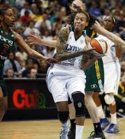Minnesota Lynx guard Seimone Augustus (33) drives through Seattle Storm forward Tina Thompson (7) in the first half of a WNBA basketball game, Sunday, May 27, 2012, in Minneapolis. (AP Photo/Stacy Bengs)