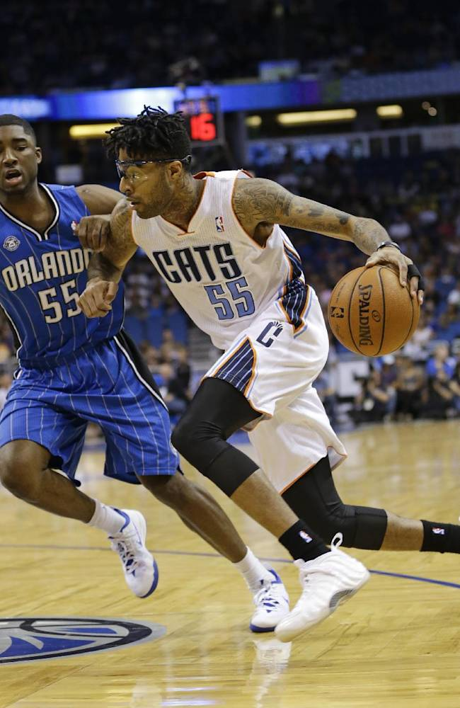 Charlotte Bobcats' Chris Douglas-Roberts, right, drives around Orlando Magic's E'Twaun Moore during the first half of an NBA basketball game in Orlando, Fla., Friday, March 28, 2014